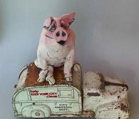 Pig on Garbage Truck