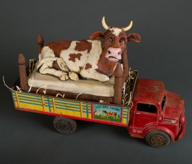 Lazy Cow on Truck Bed
