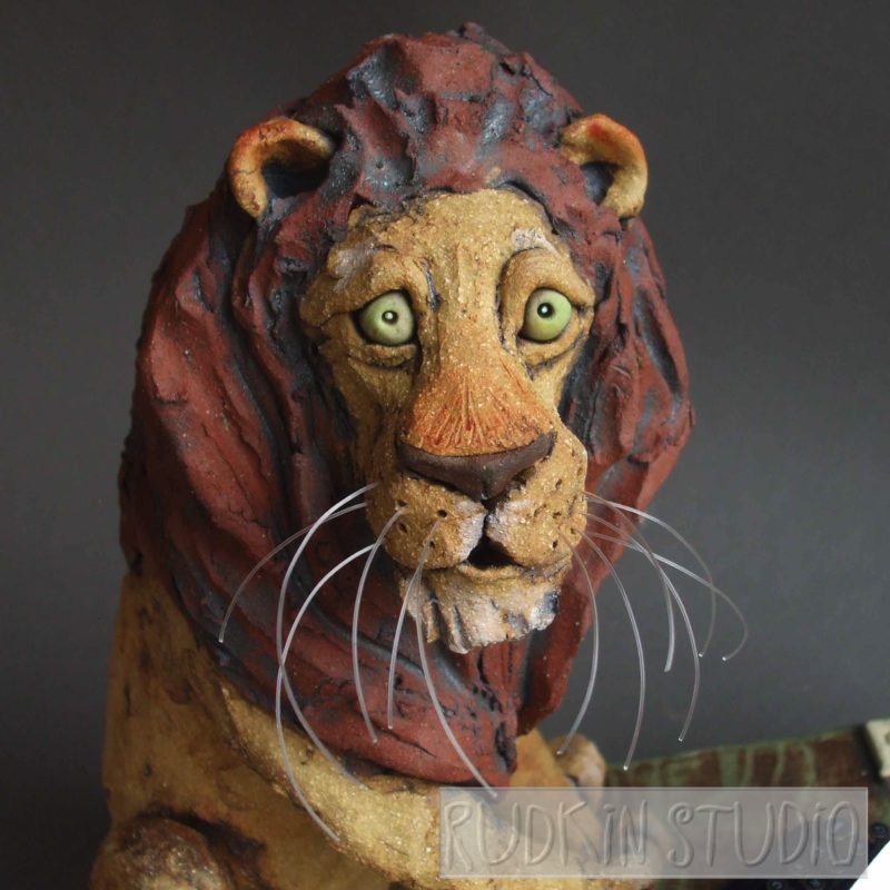 Lion Sculpture Typing Close